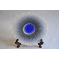 Assiette en porcelaine d'art signée Langford