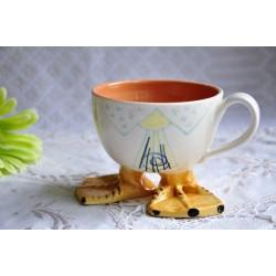 Tasse à pattes palmées en poterie artisanale